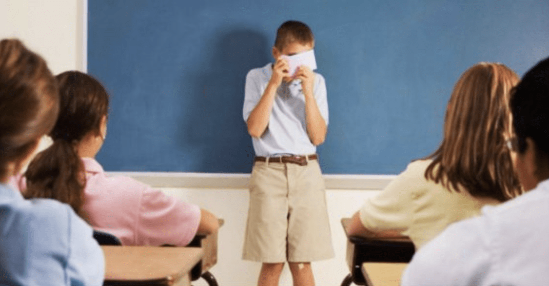 shy kid in front of the class.png