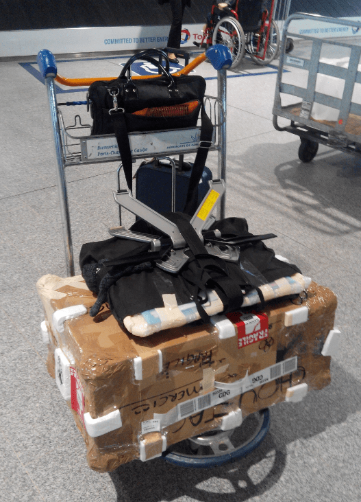Wqcom Cintiq transportation with imac 21 inch airport plane charles de gaulles paris changi airport singapore.png