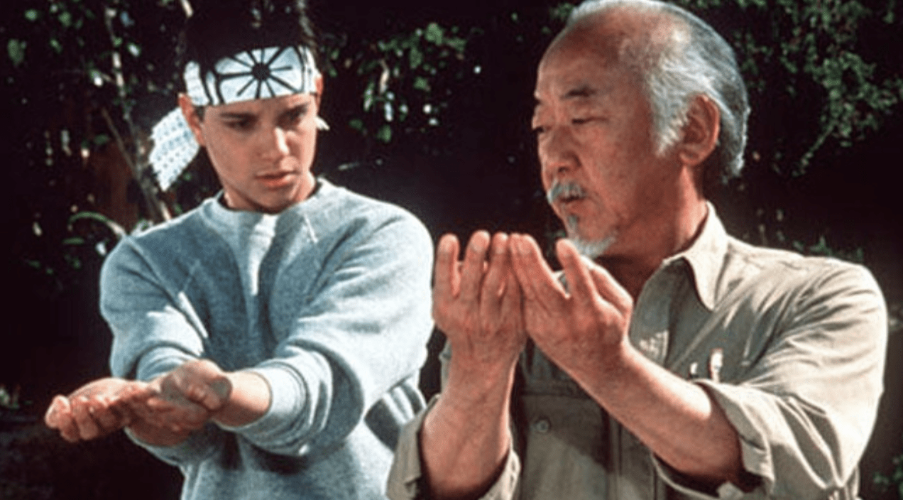 master miyagi karate kid teaching student the right movements.png