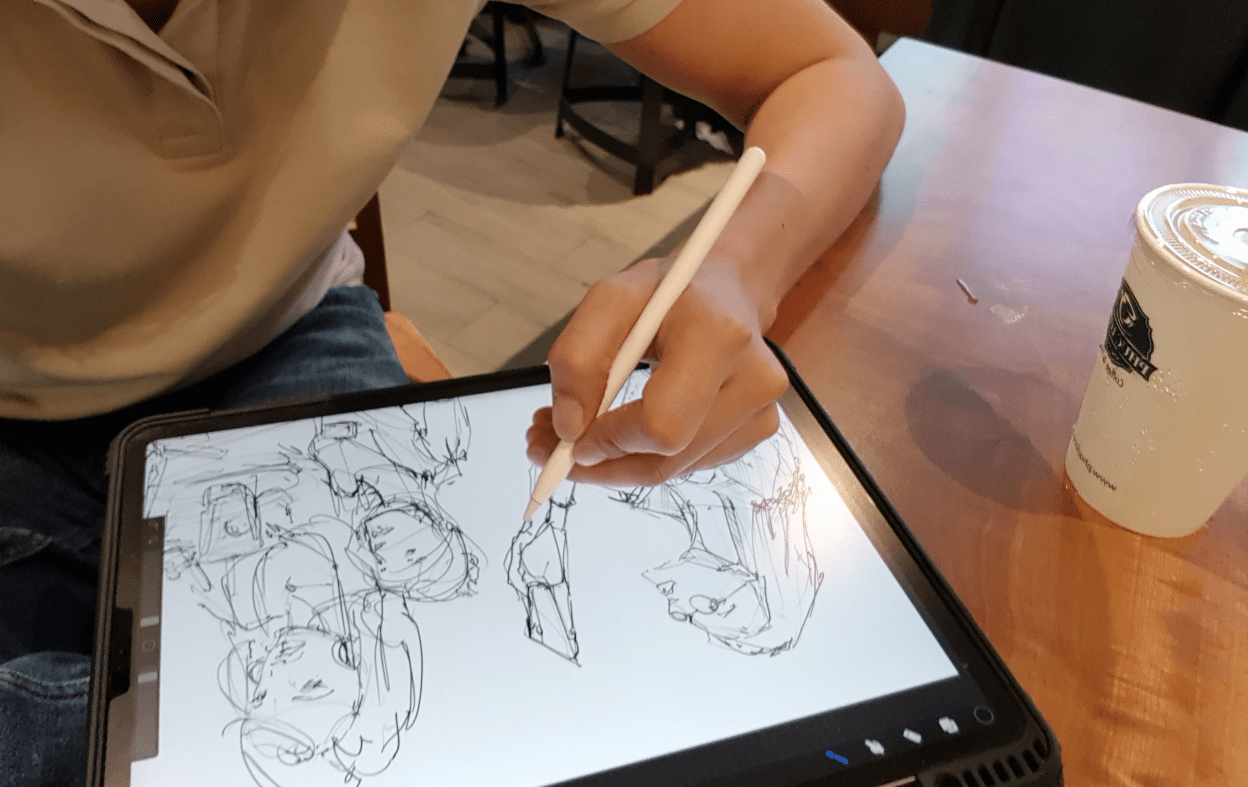 sketching at Phuc Long cafe in Vietnam loosen up your lines to draw people with ipad pro and pencil dont give up drawing too early a
