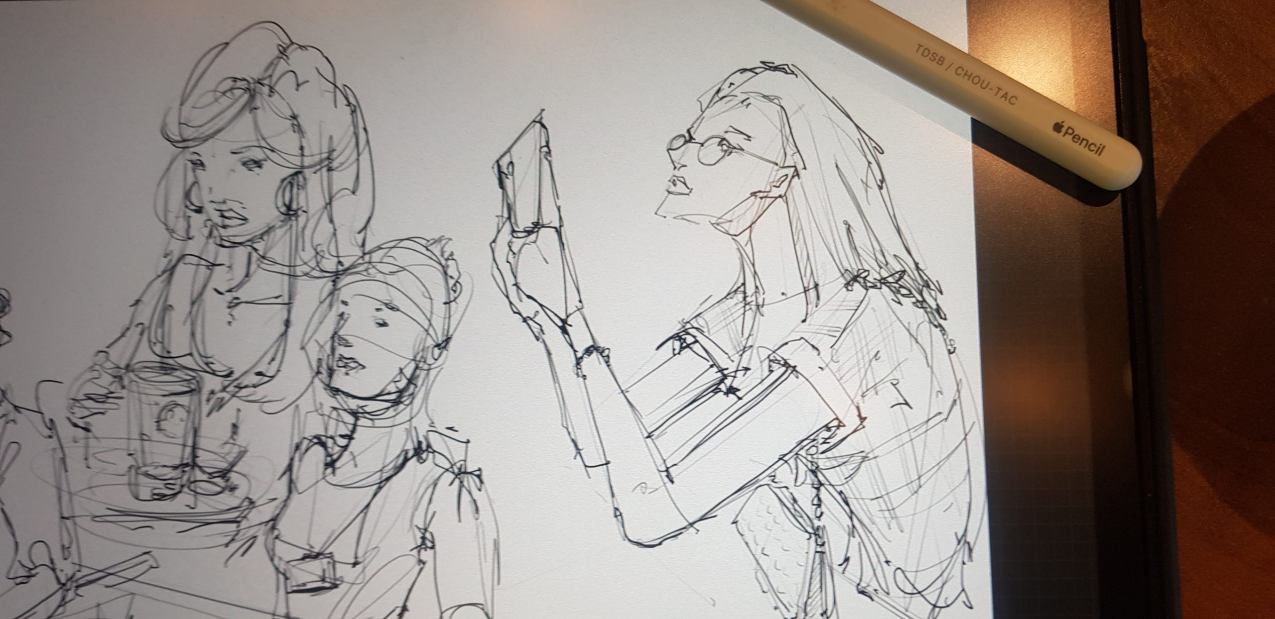 sketching at Phuc Long cafe in Vietnam loosen up your lines to draw people with ipad pro and pencil dont give up drawing too early elongated arms